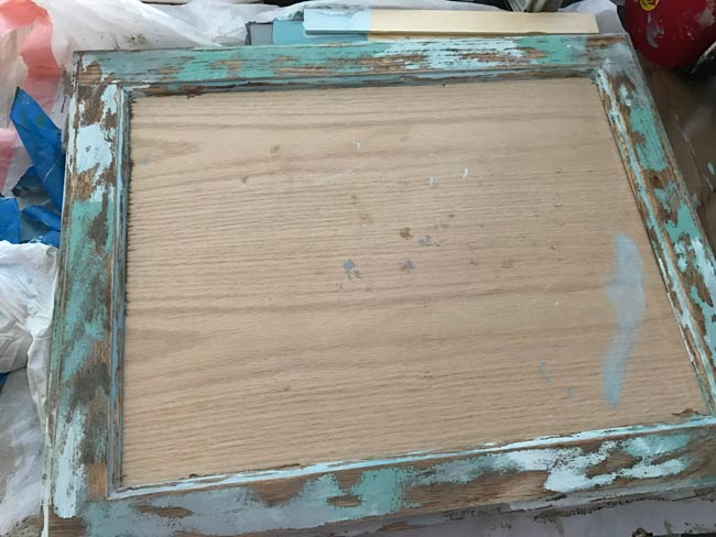 Cabinet door frame after I used an orbital sander to buff out areas of the dry paint