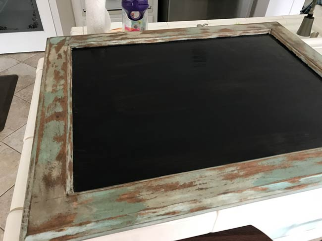 Chalkboard paint drying on cabinet door face