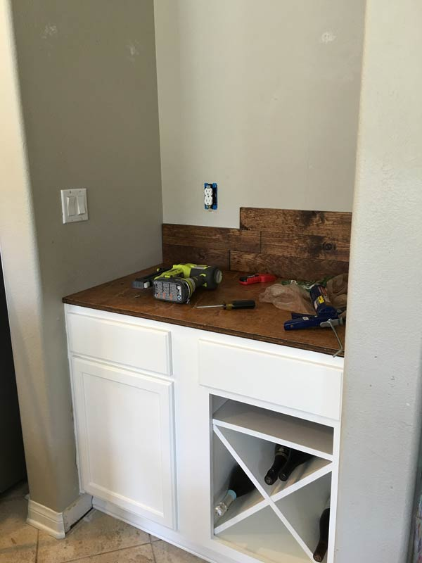 Installing wood wall with liquid nails and finishing nails