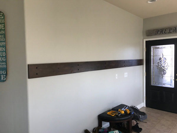 """Secured the stained plank to the wall using 2"""" Decorative #18 Diamond Head Screws from Old West Iron"""